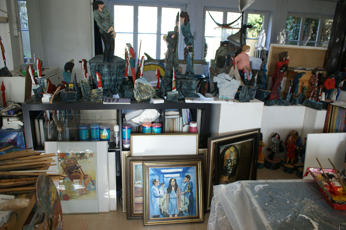 View into the studio with pictures and sculptures